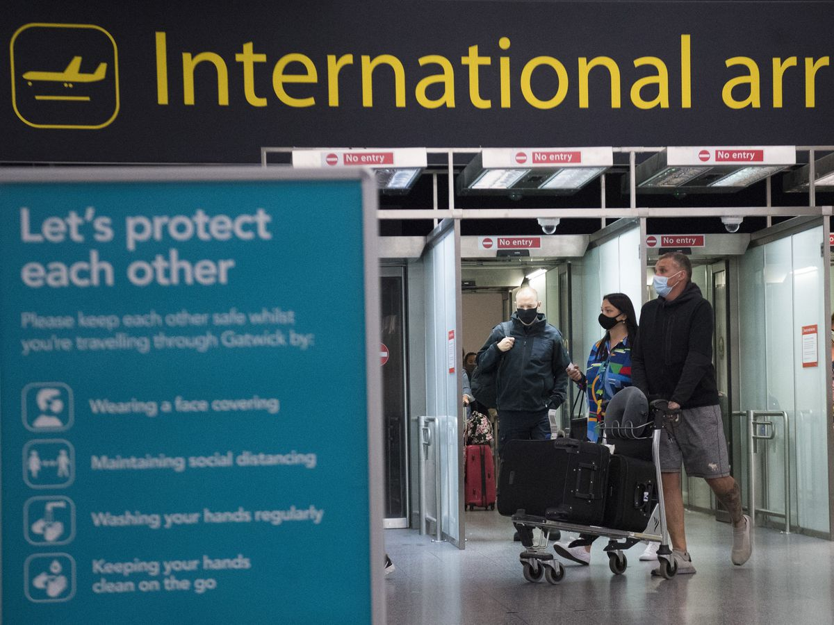 Passengers arrive at Gatwick Airport