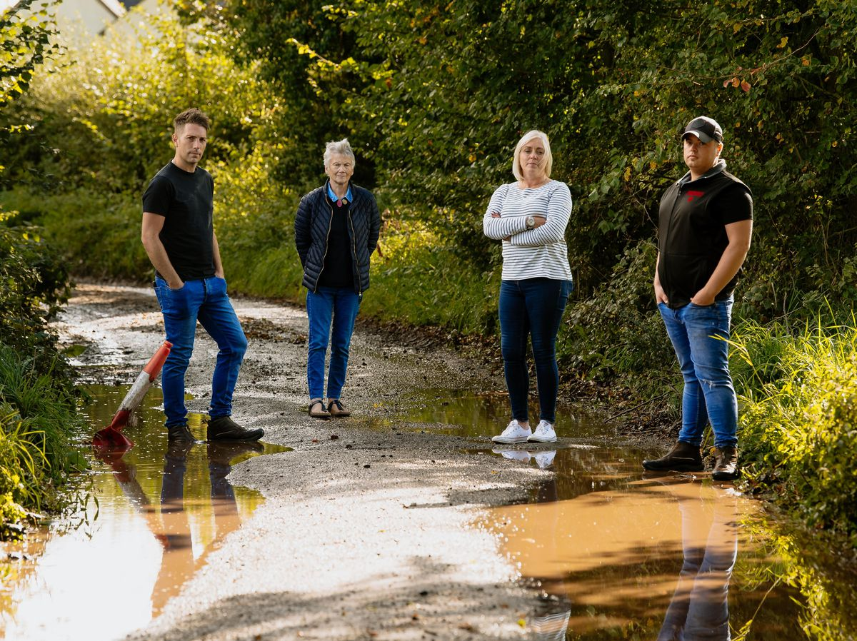 The people who use the unnamed road in Little Soudley every day are fed up of the poor state of the road surface. From left are Nick Partridge, Judy Udale, Sue Preece and Mike Yates