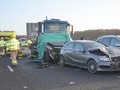 Lorry driver who was accessing apps on phone before fatal minibus crash jailed
