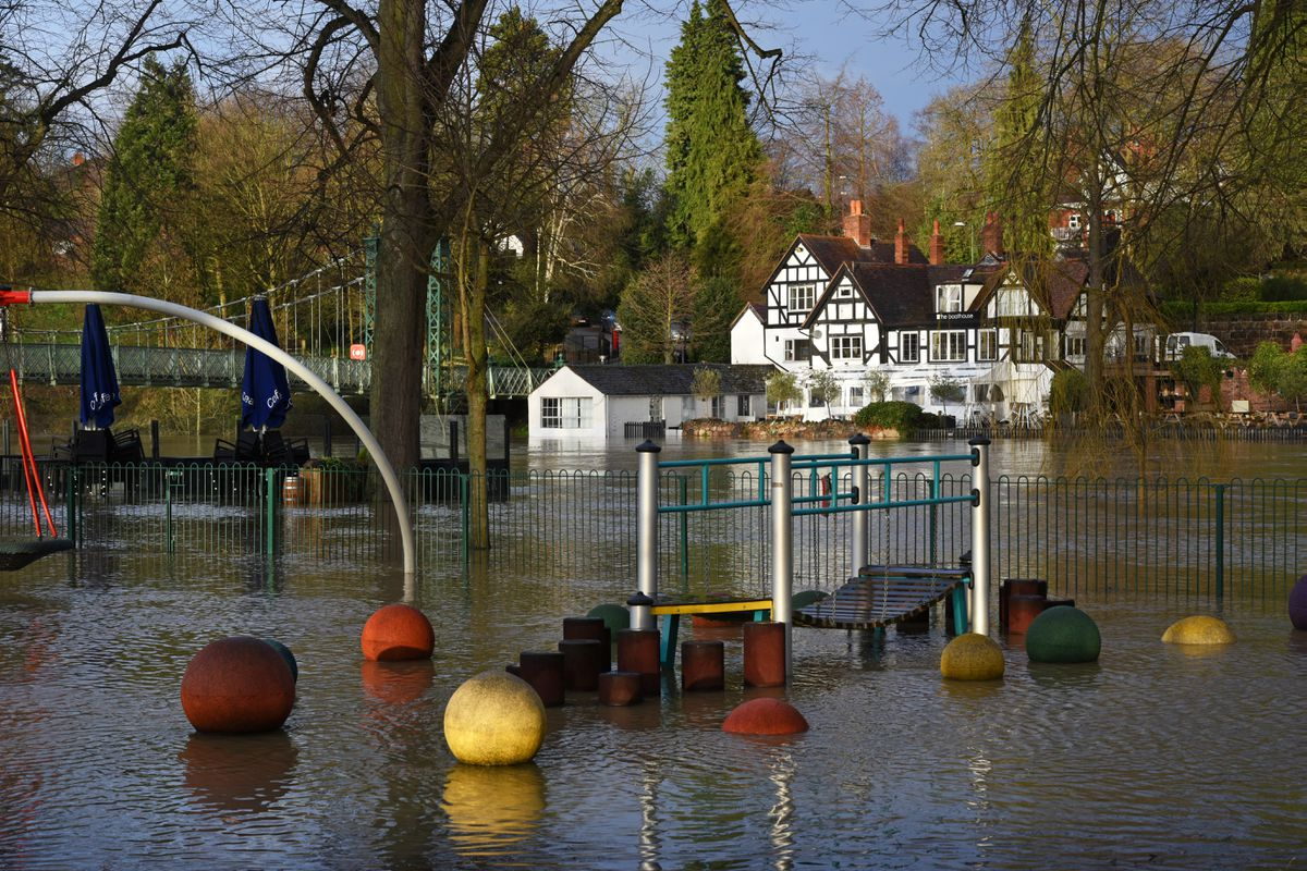 Shrewsbury flooding: The River Severn and the Boathouse Inn at Quarry Park. Pic: Russell Davies