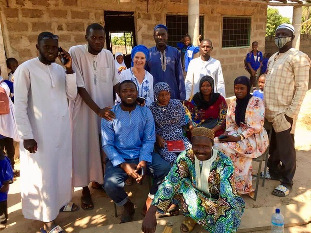 'Goal for The Gambia' founder, Sandy Sanyang with school staff and village elders.