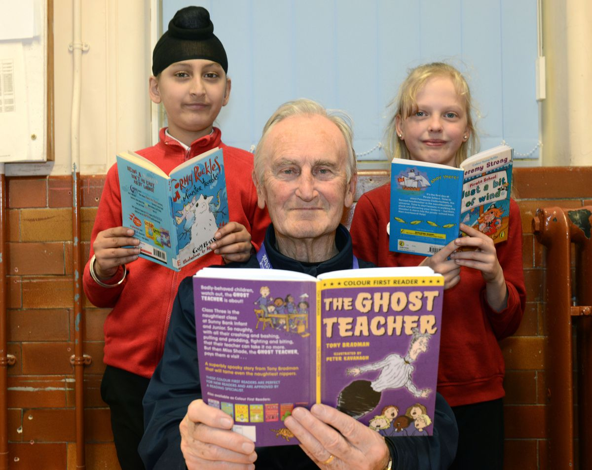 Former England Cricket captain Ted Dexter pictured helping pupils to read at Graiseley Primary School