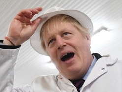 Boris Johnson takes reporter's phone after refusing to look at photo