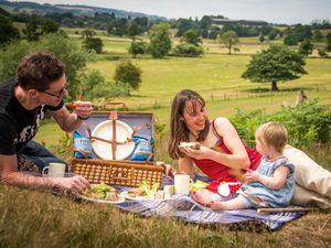 Fordhall Community Land Initiative manager Charlotte Hollins enjoying a picnic with her family