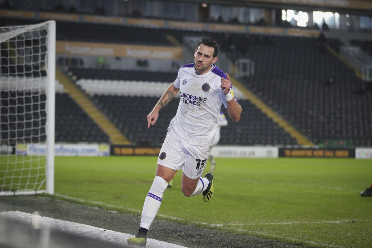 Charlie Daniels of Shrewsbury Town celebrates after scoring a goal to make it 0-1.