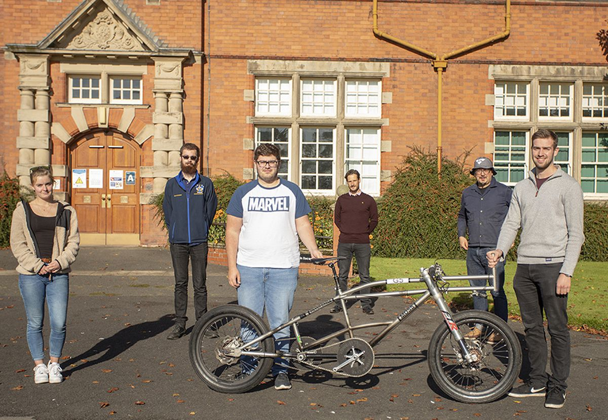 Operation Pacemake students with Neil Campbell (back, maroon jumper). L-R Emily Jones, Martin Campbell, Will Mosley, Neil Campbell, Andrew Jones from Moss Bikes, and James Seymour