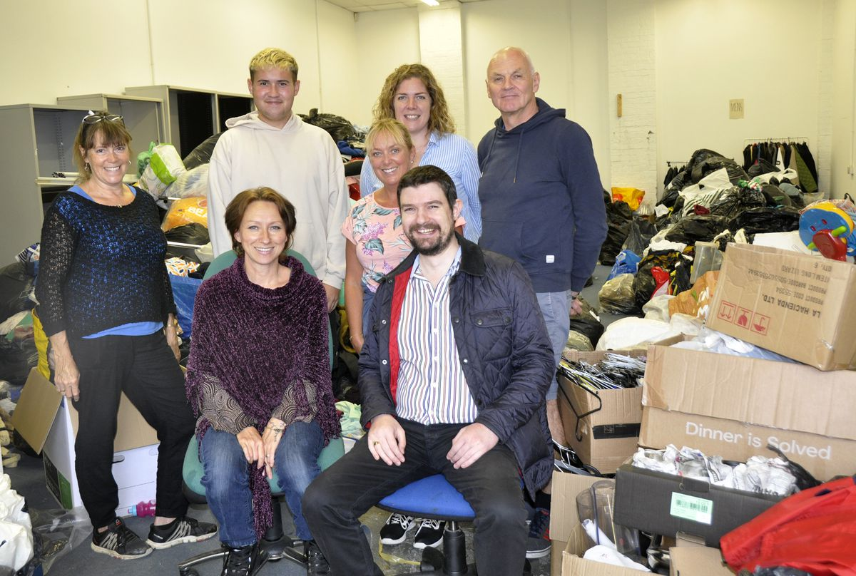 The Shropshire Supports Refugees team, with Councillor Dean Carroll, at their new storage unit