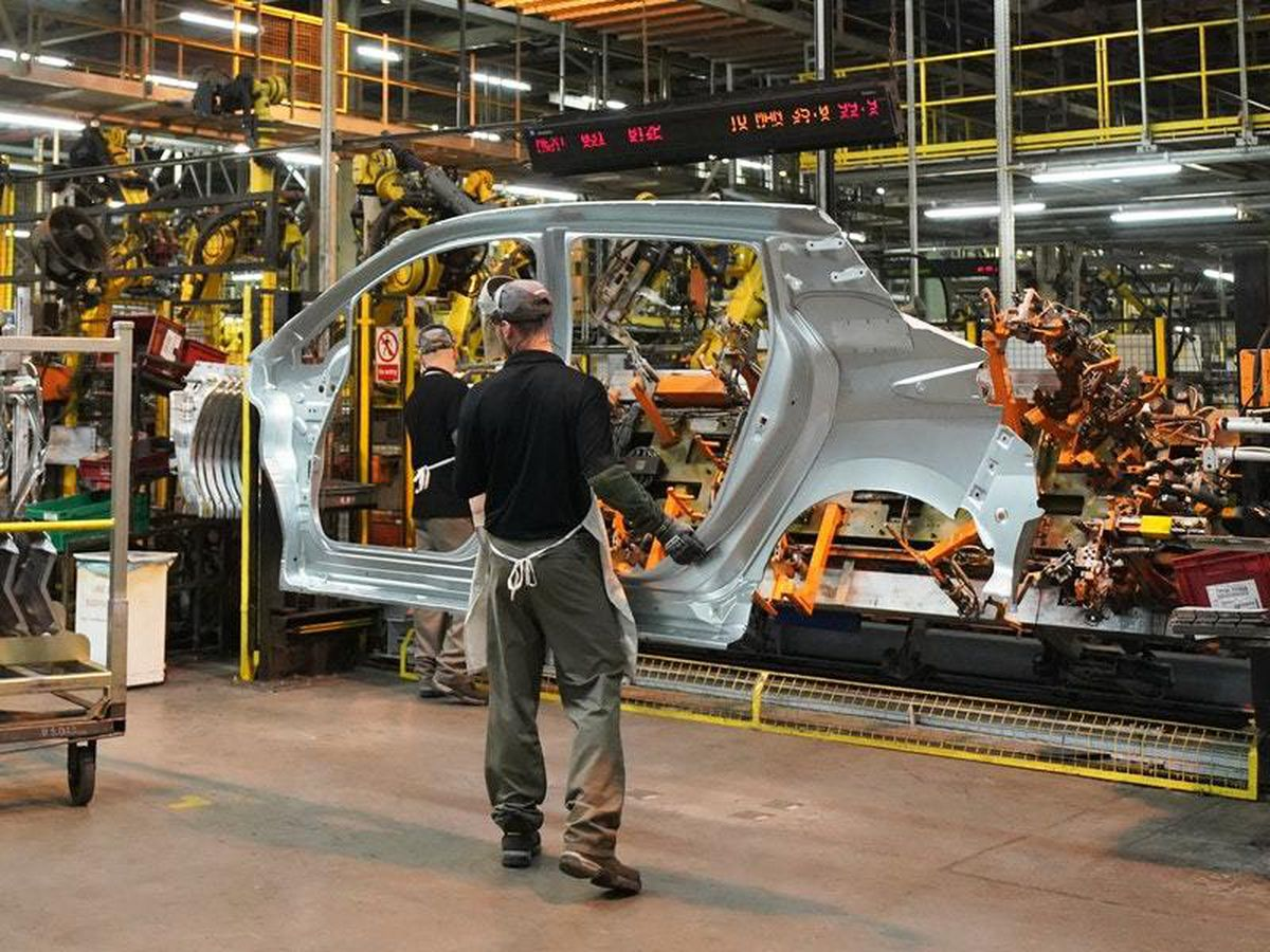 Nissan worker on assembly line