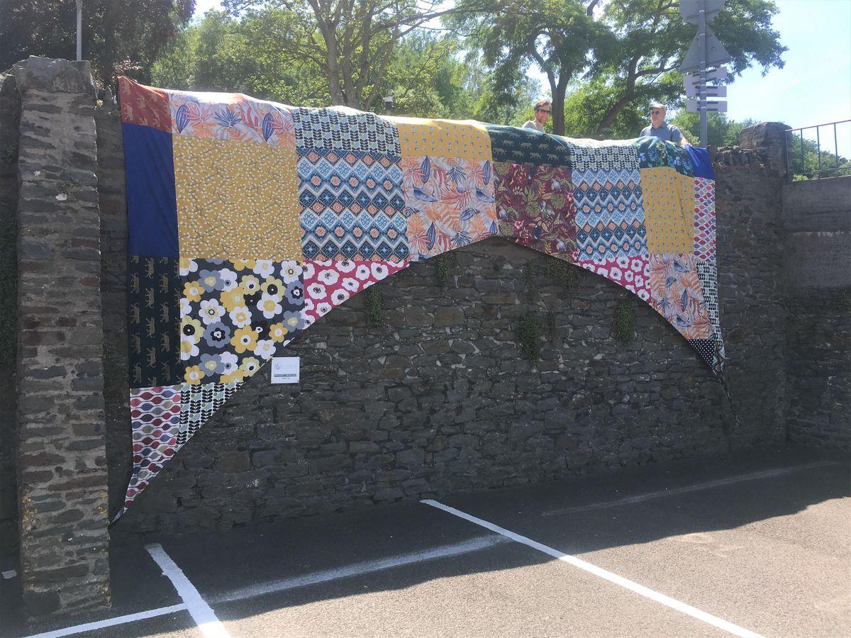 Patchwork panels of 'Bridges, Not Walls' Llangollen Bridge artwork by artist Luke Jerram