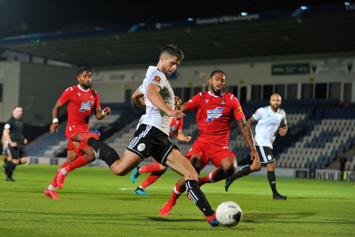 Jason Oswell shoots during the pre-season friendly between AFC Telford United and Wrexham