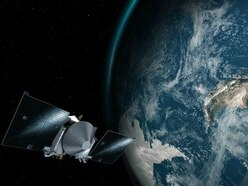 Nasa's Osiris-Rex asteroid-chaser passes Earth on way to space rock