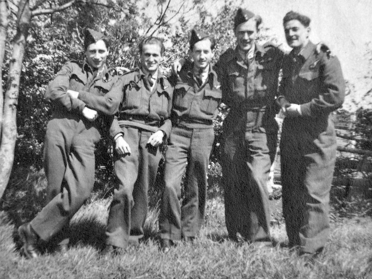Who are they? Van's cherished keepsake of a wartime bomber crew. Photo: Rob Davis