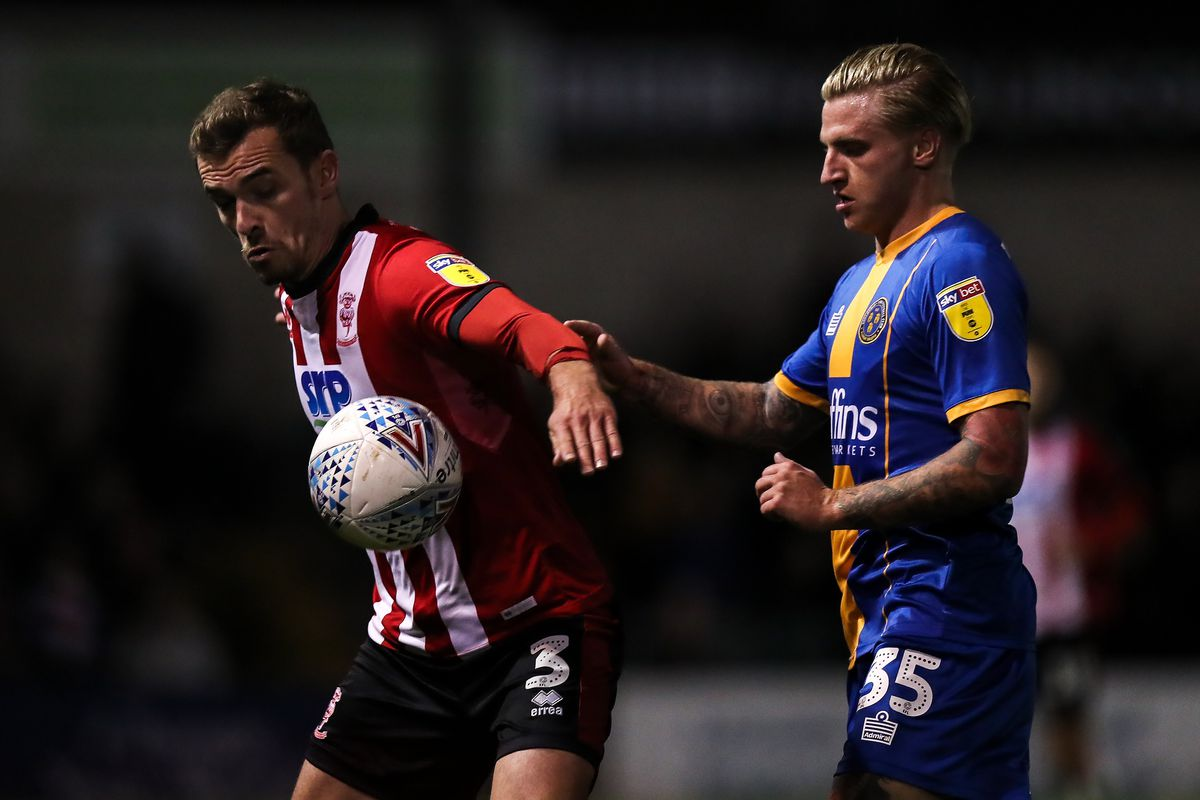 Harry Toffolo of Lincoln City and Jason Cummings of Shrewsbury Town (AMA)