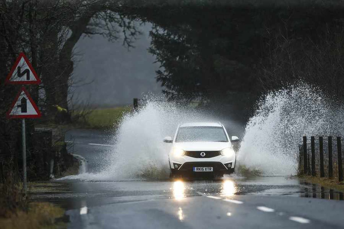 Shropshire border road closed by rising flood waters