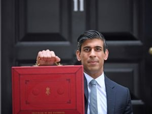 Chancellor of the Exchequer, Rishi Sunak, holds his ministerial 'Red Box' outside 11 Downing Street, London, before heading to the House of Commons to deliver his Budget. Picture date: Wednesday March 3, 2021. PA Photo. See PA story POLITICS Budget. Photo credit should read: Victoria Jones/PA Wire