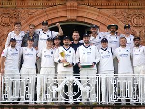 Warwickshire pose on the dressing room balcony with the Bob Willis Trophy
