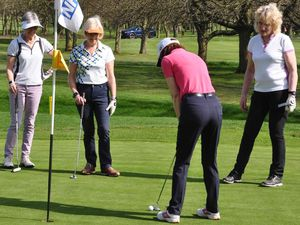 Women's Captain Pat Alexander (right) on the putting green with members