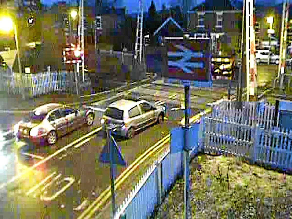 CCTV footage shows a driver crossing the line despite the flashing lights