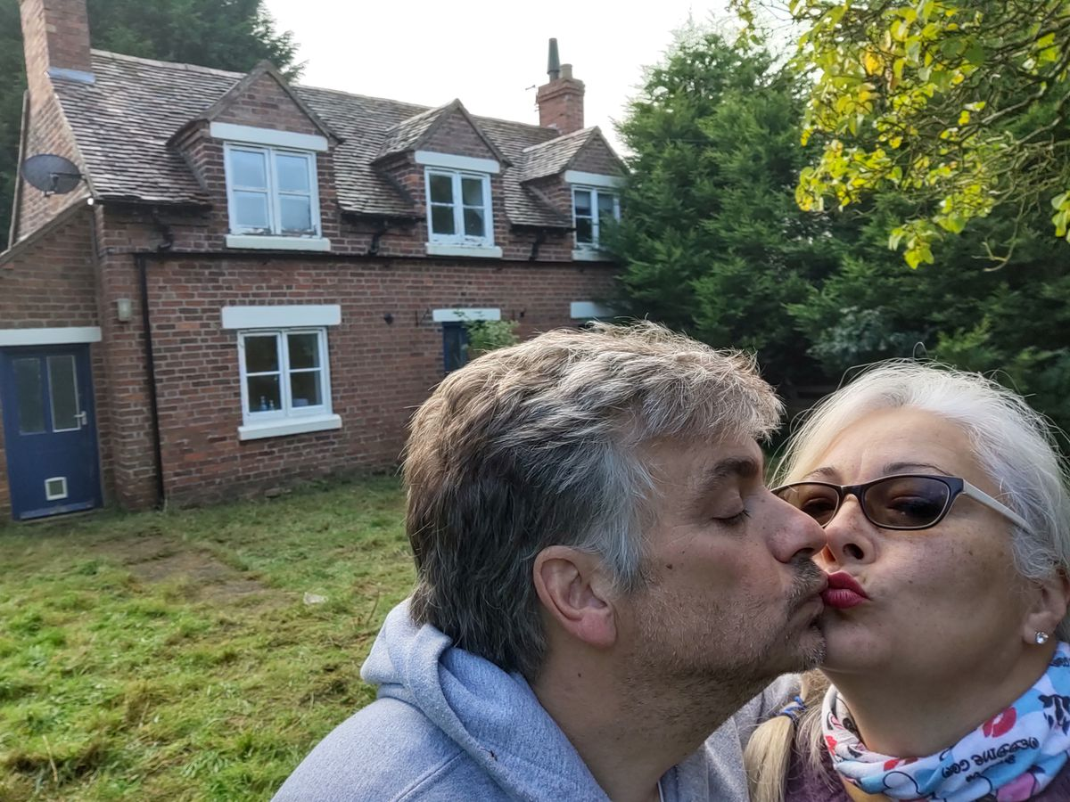 Philip and Dee Rand outside their 'dream' cottage