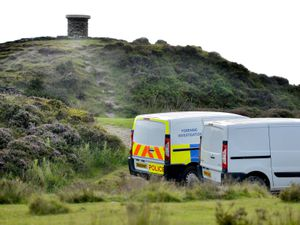 Investigators at the top of Brown Clee Hill, Craven Arms, where a body has been found