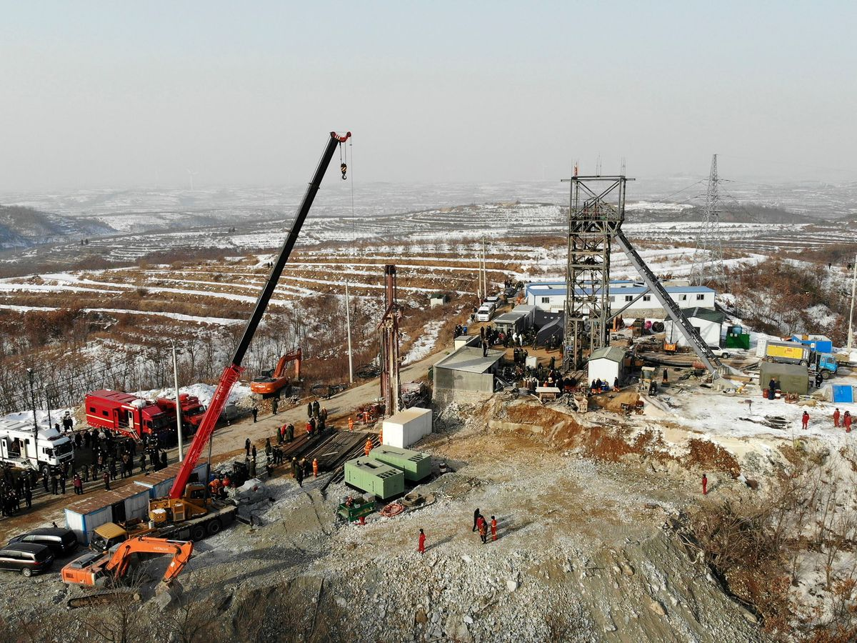 Rescuers work at the site of a gold mine that suffered an explosion in Qixia in eastern China's Shandong Province