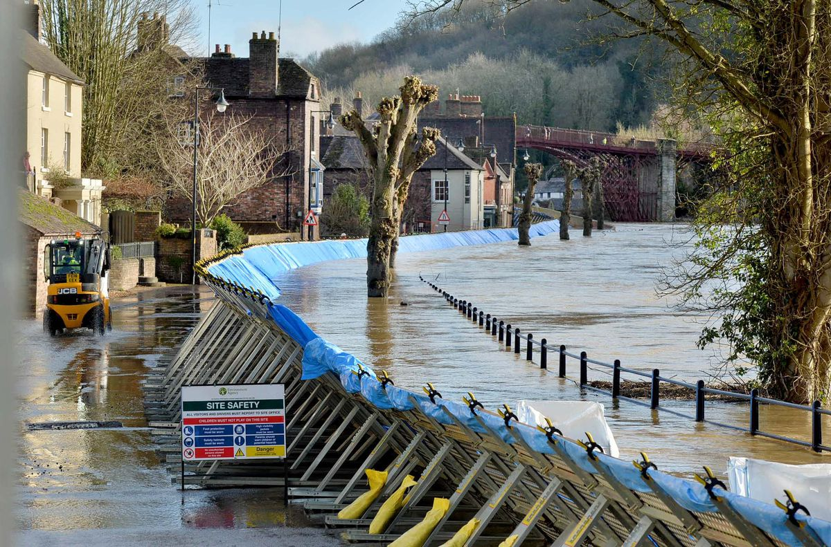 Flood water next to the barriers in Ironbridge on Friday