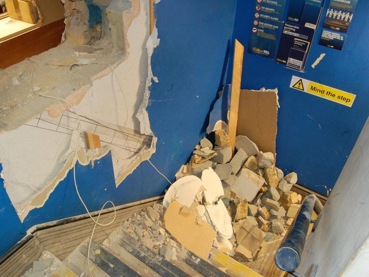 The hole in the wall in the William Hill betting shop on Fleet Street in London