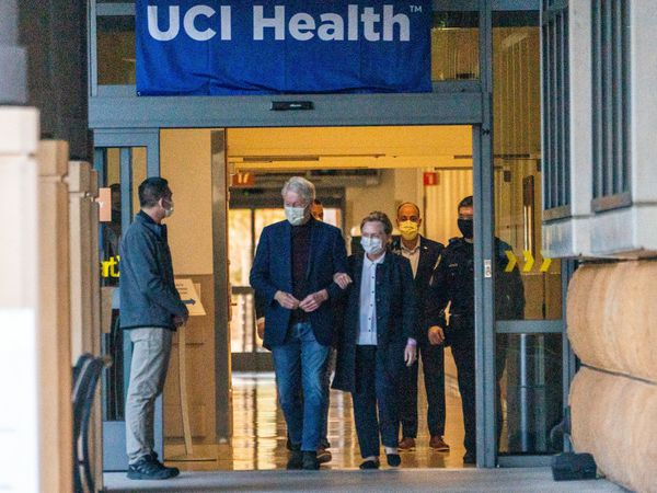 Bill Clinton leaving hospital with his wife Hillary