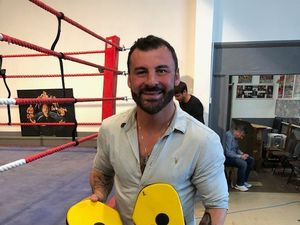 Joe Calzaghe with the pads that Richie Woodhall is raffling