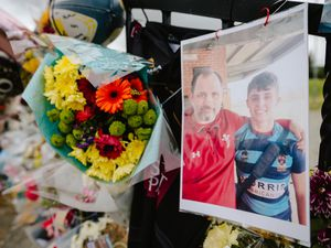 Floral tributes are attached to the gates at the Bishop's Castle rugby club in memory of Dylan Price