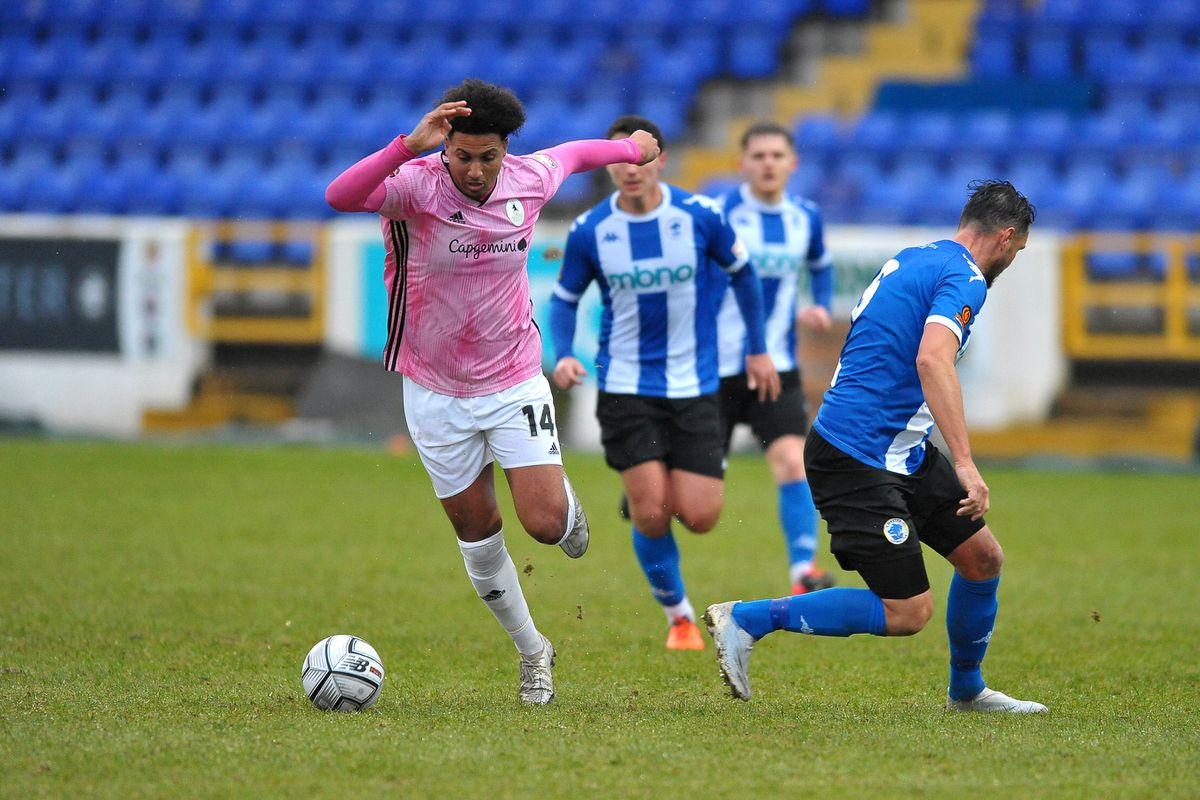 TELFORD COPYRIGHT MIKE SHERIDAN Dom McHale of Telford heads past Simon Grande of Chester(formerly AFC Telford) during the Vanarama Conference North fixture between AFC Telford United and Chester FC at Deva Stadium on Saturday, January 2, 2020...Picture credit: Mike Sheridan/Ultrapress..MS2021-053.