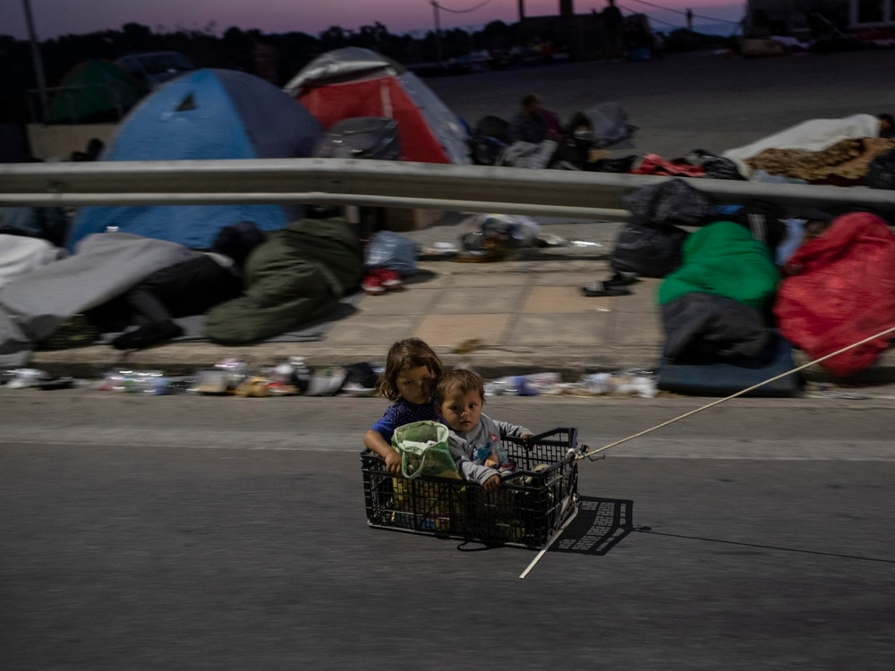 Tension, looming health crisis on Lesbos island after camp fire