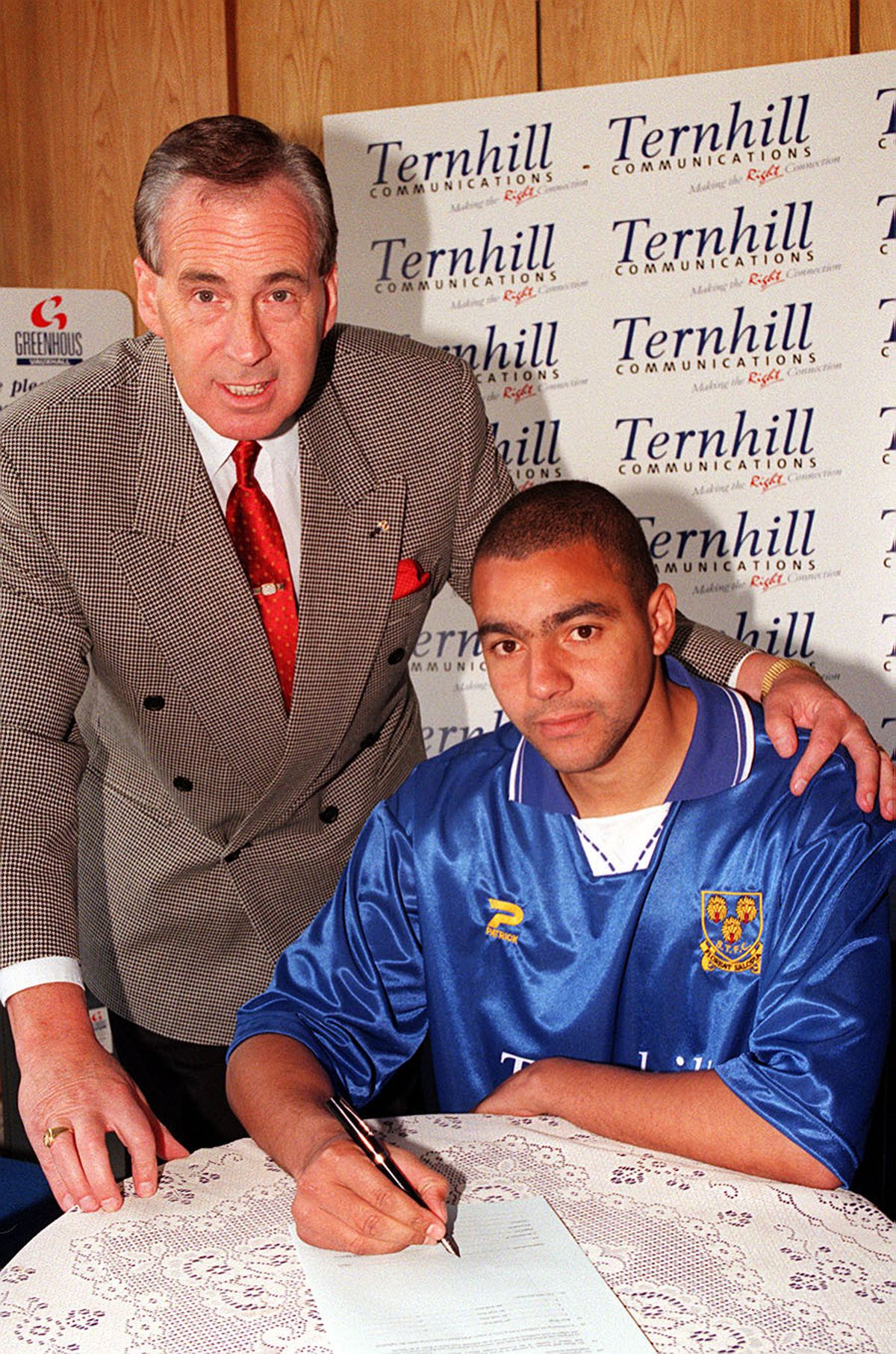 Spencer Whelan agrees to join Shrewsbury from Chester in 1998 and signs on with chairman Roland Wycherley