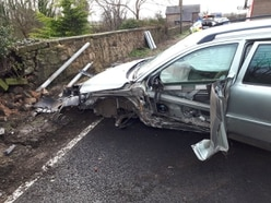 Car crashes into wall near Oswestry