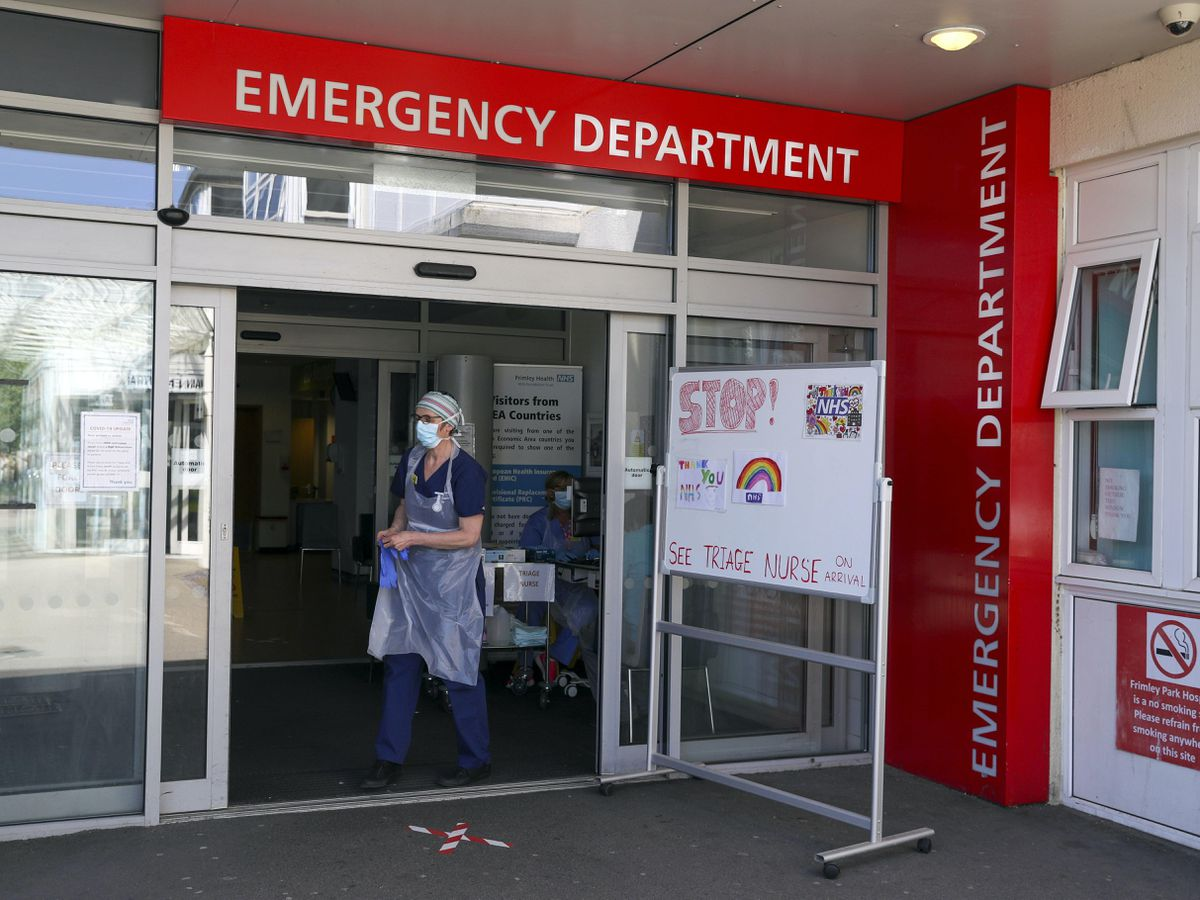 A triage nurse waits for patients