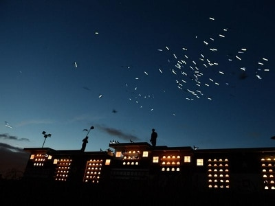 Watch 1,500 pigeons with LED lights fly over London in a spectacular art display