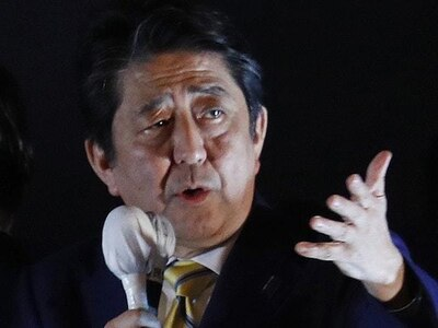 Shinzo Abe's ruling coalition wins Japanese election, exit polls suggest