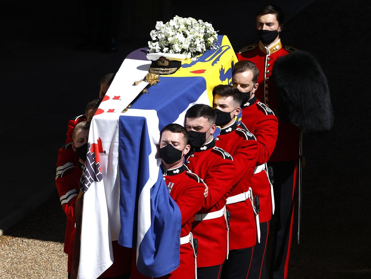 Guardsman Sam Tudor, 21, of Telford, of the 1st Battalion Grenadier Guards (second on the right) carries the duke's coffin