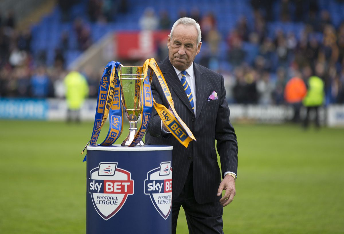 Shrewsbury Town chairman Roland Wycherley and the Sky Bet football league runners up trophy. (AMA)
