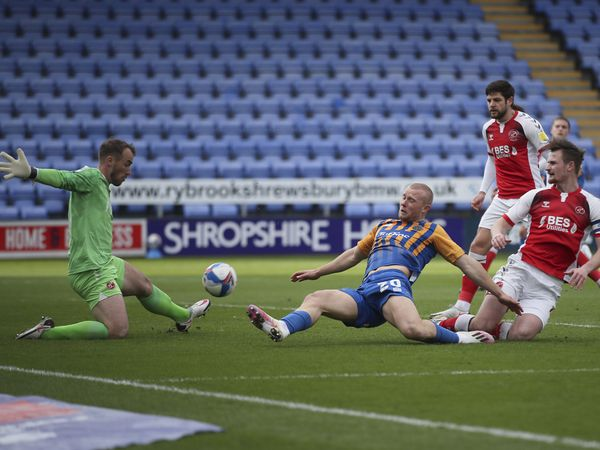 Alex Cairns of Fleetwood Town saves from Curtis Main of Shrewsbury Town (AMA)