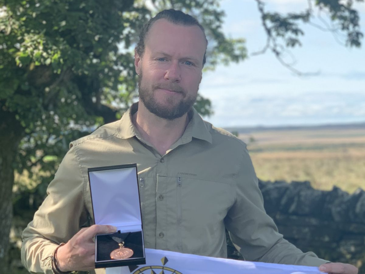 Chaz Powell with his 'Explorer of the Year' award