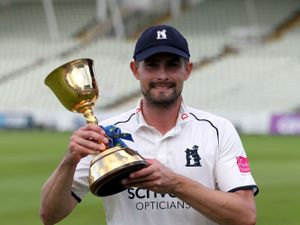 Warwickshire captain Will Rhodes with the trophy after becoming champions by winning the LV= Insurance County Championship division one match at Edgbaston Stadium, Birmingham. Picture date: Friday September 24, 2021. PA Photo. See PA story CRICKET Warwickshire. Photo credit should read: Bradley Collyer/PA Wire.   RESTRICTIONS: Editorial use only. No commercial use  without prior written consent of the ECB. Still image use only. No moving images to emulate broadcast. No removing or obscuring of sponsor logos.