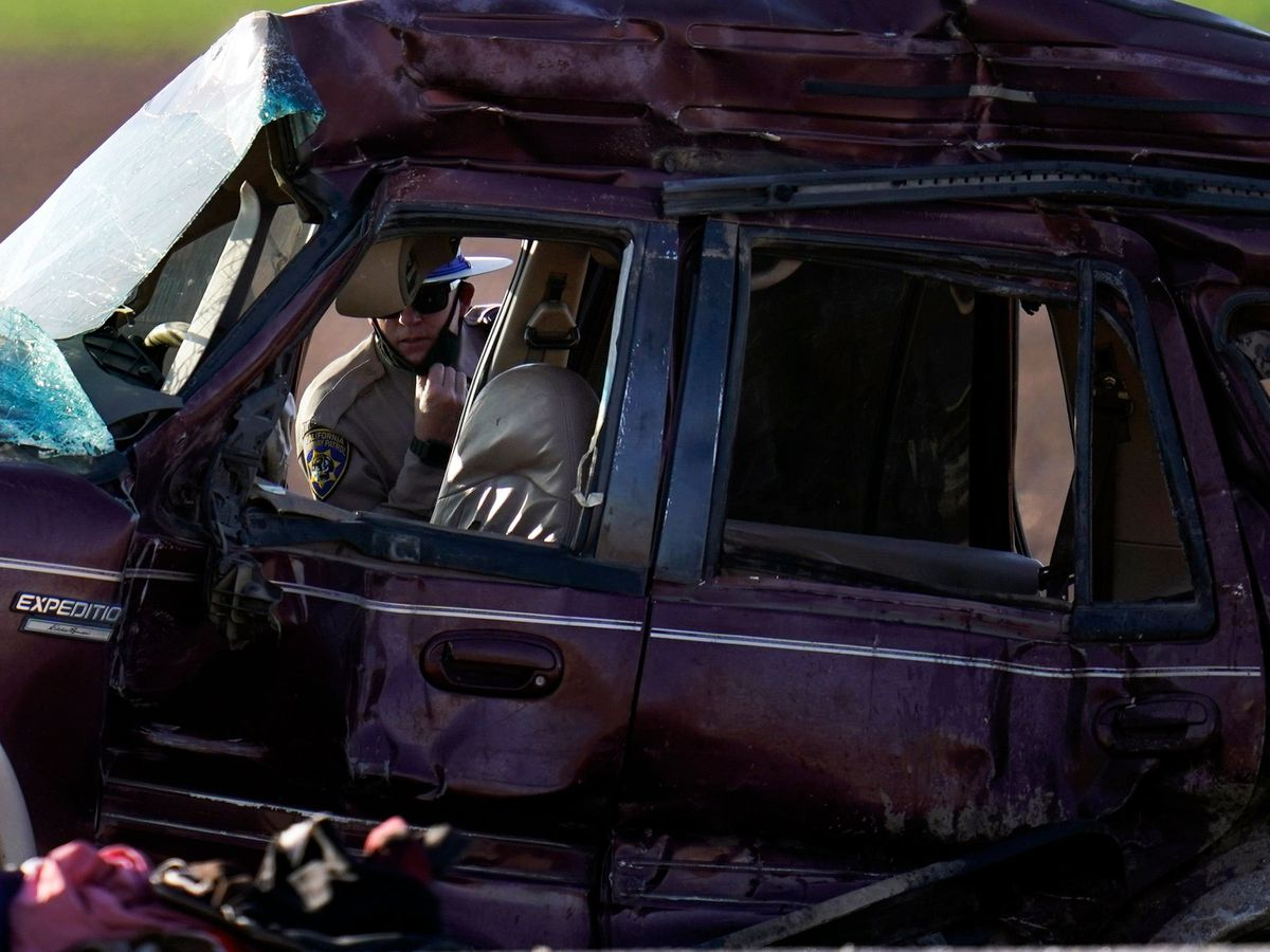 A California Highway Patrol officer examines the scene of a deadly crash in Holtville, California