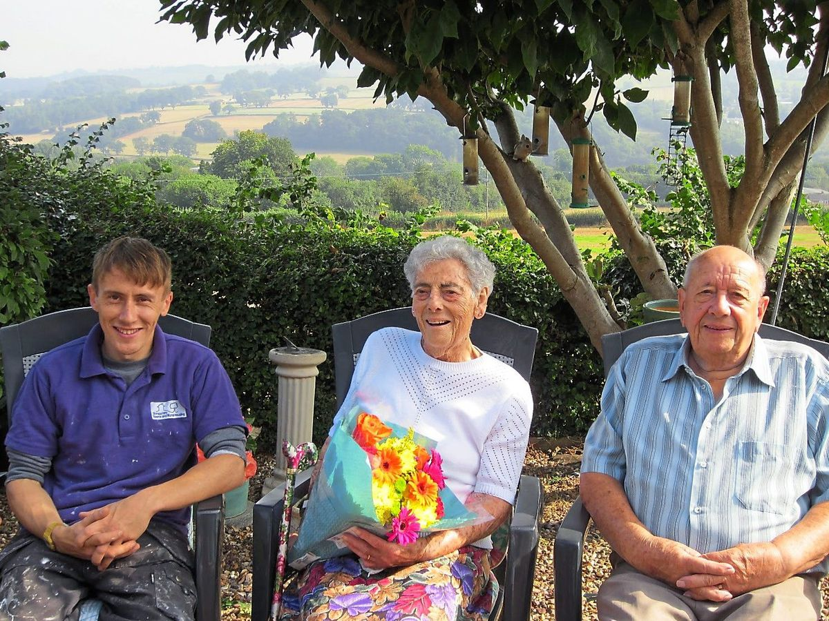 Martin Flindall, repairs operative from Shropshire Towns and Rural Housing, with William and Winifred Carson