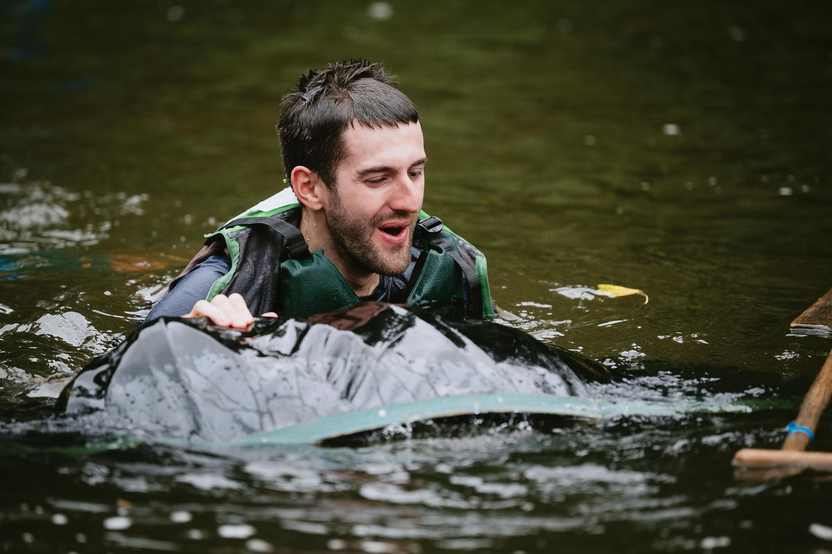 Ollie Sydenham ends up in the water during the Ironbridge Coracle Regatta