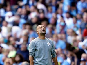 Manchester City manager Pep Guardiola watches on frustrated