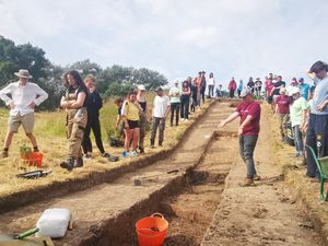 Nat Jenkins shows visitors to the dig some of the trench
