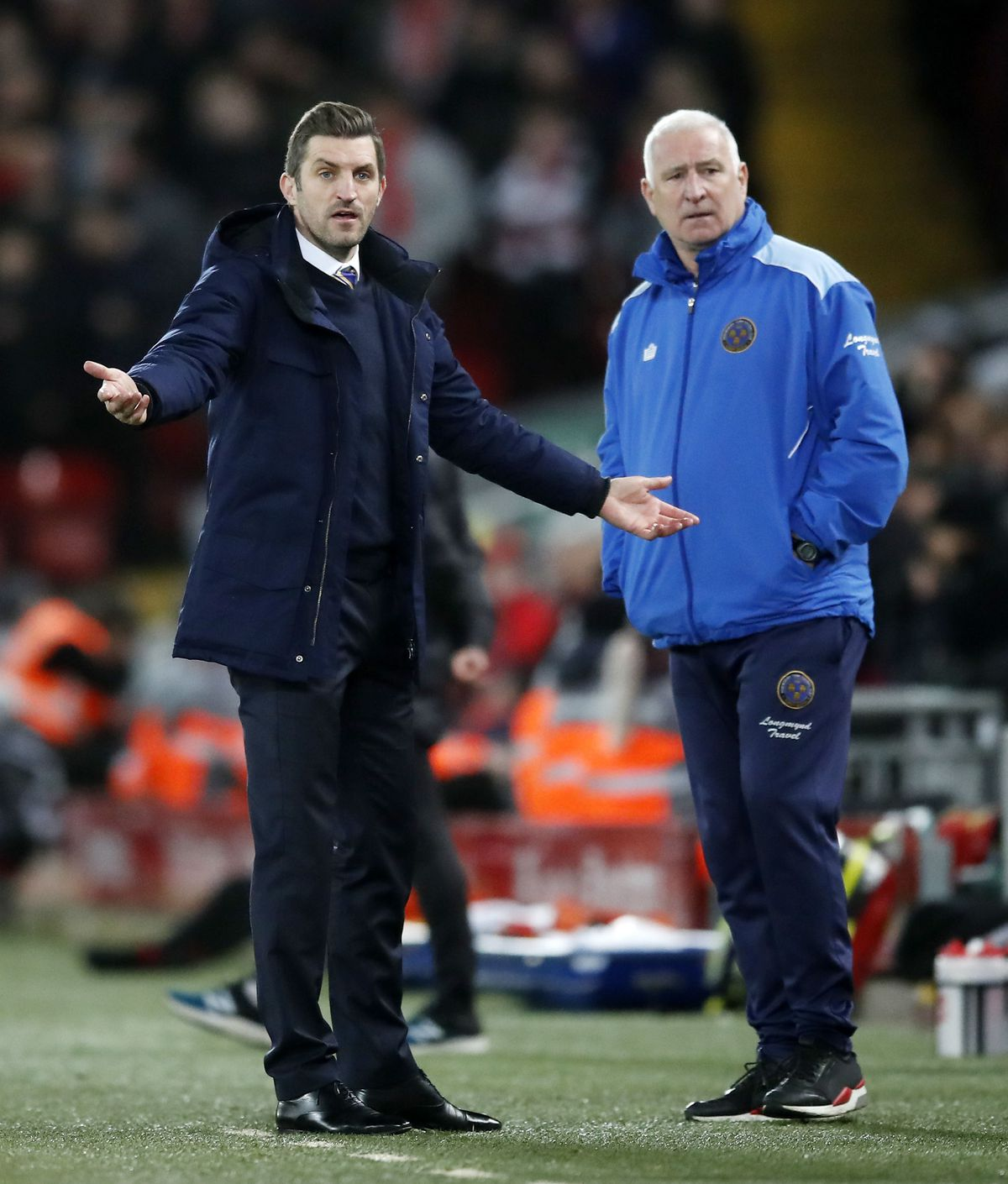 Sam Ricketts and Graham Barrow watch on at Anfield