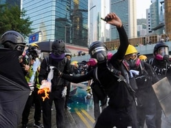 Violence flares after Hong Kong protesters defy police ban