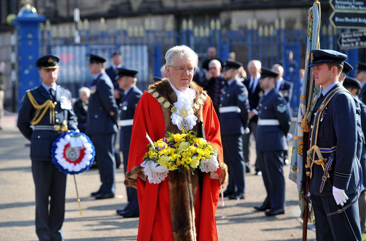 Shrewsbury mayor Phil Gillam gets ready to lay a wreath